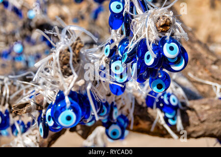 Nazars hanging from a tree in Goreme, Cappadocia, Turkey - Stock Image