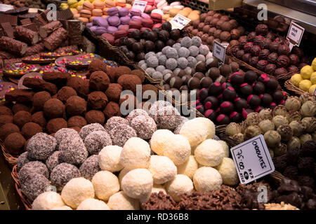Chocolates at a market stall - Stock Image