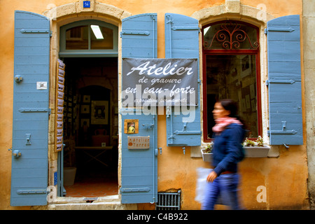 Arles; Bouches du Rhone, France; A young woman walking in front of an Atlelier's (artist's studio). MR. - Stock Image