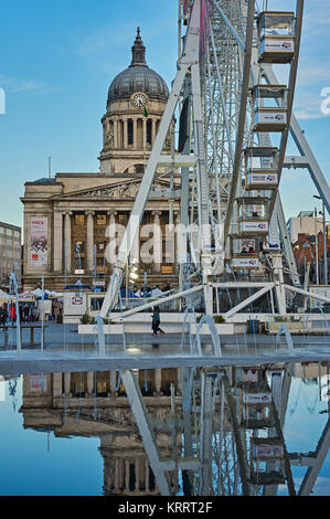 Nottingham city centre with the Council House building and Big Wheel reflected in the city centre water feature - Stock Image