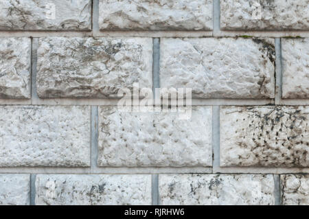 Carrara, Italy: Marble wall made with hand-carved blocks - Stock Image