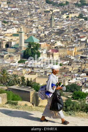 Fez, Fes, Morocco, North Africa. Moroccan hawker looking down on Fez, Morocco, North Africa. - Stock Image