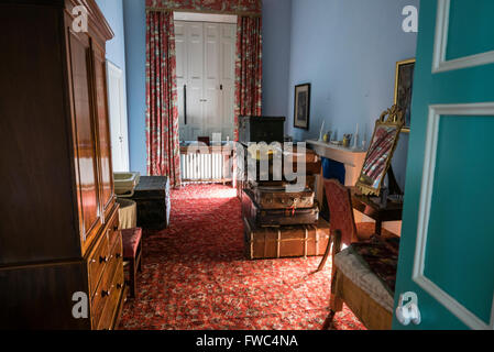Luggage stored in a large closet room in an old fashioned stately home - Stock Image