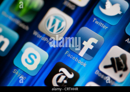 Muenster, Germany, February 2, 2012: Image of the iphone touch screen. Display shows a collection of useful apps. - Stock Image