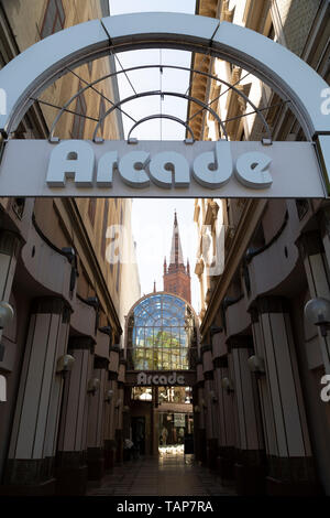 The Arcade in Wiesbaden, the state capital of Hesse, Germany. The passage has shops. - Stock Image