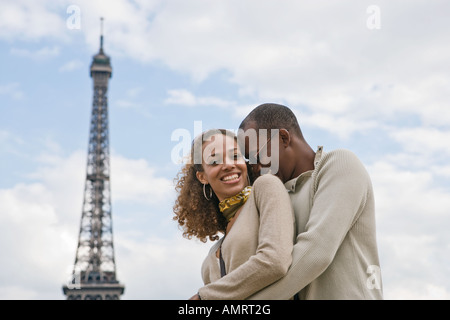 African couple hugging - Stock Image