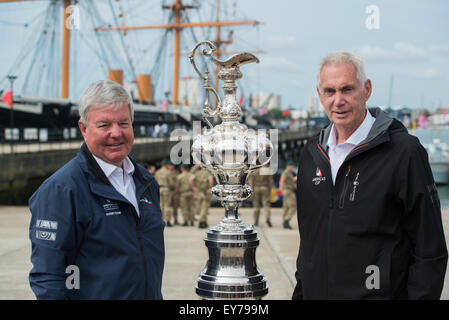 Portsmouth, UK. 23rd July 2015. Sir Keith Mills and Dr Harvey Schiller pose with the America's Cup in-front - Stock Image