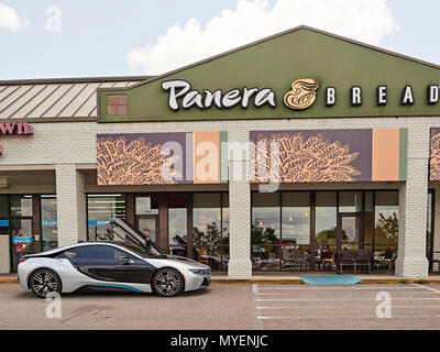 BMW i8 luxury electric hybrid plug-in super car parked in front of Panera Bread in Opelika Alabama, USA. - Stock Image