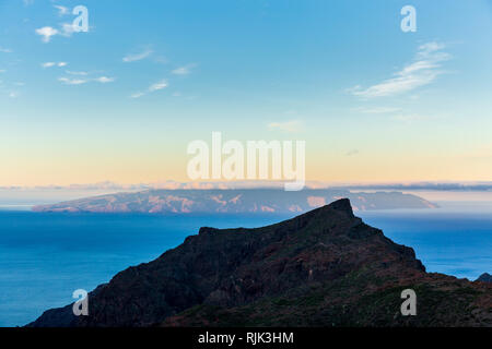 View west to La Gomera from the ridge above Masca barranco at dawn on Tenerife, Canary Islands, Spain - Stock Image