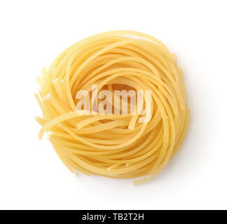 Top view of uncookedi pasta nest isolated on white - Stock Image