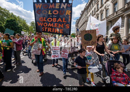 London, UK. 12th May 2019. Women of Colour in the Global Women's Strike on the XR International Mothers Day March by several thousand mothers, children and some fathers from Hyde Park Corner to a rally filling Parliament Square, backing Extinction Rebellion's call for the drastic and urgent action needed to avert the worst consequences of climate change, including possible human extinction. Our politicians have declared a climate emergency but now need to take real action rather than continuing business as usual which is destroying life on our planet. Peter Marshall/Alamy Live News - Stock Image