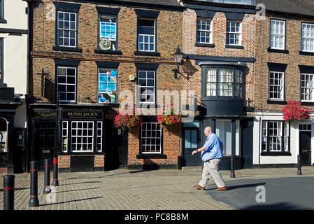 Man walking past Blind Jack's pub, Knaresborough, North Yorkshire, England UK - Stock Image