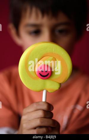 Boy with lollipop - Stock Image
