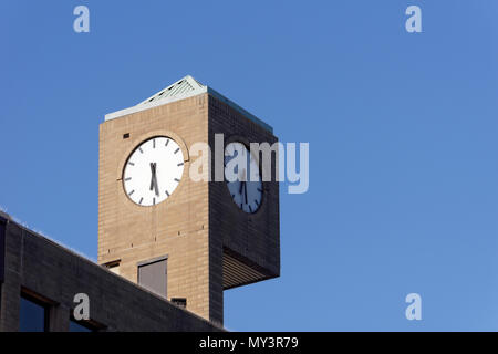 Outdoor clock on the The Clock Tower building at the corner of West Broadway and Granville Street in Vancouver, BC, Canada - Stock Image