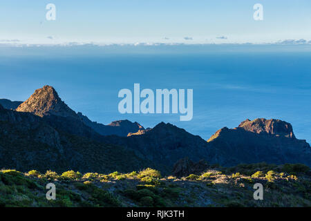 Dawn sunlight lights up the Risco Blanco and ridges over the Masca barranco in the Teno region of Tenerife, Canary Islands, Spain - Stock Image