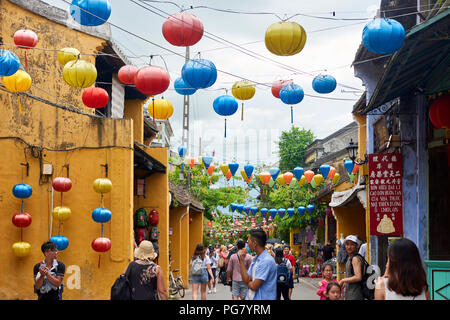 The UNESCO protected town of Hoi An, in Vietnam,  decorates their streets with traditional chinese style lanterns. At night, tourists place candles in - Stock Image