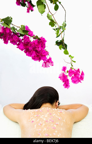 Woman receiving an organic scrub treatment - Stock Image