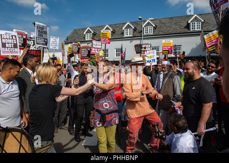 Worcester, United Kingdom. 1 September 2018. The English Defence League (EDL) held a national demonstration in the West Midlands town of Worcester, approximately 200 people attended. A counter-protest was held a short distance away with approximately 500 people. PICTURED: Counter-protesters dance at a rally point in Worcester town centre Credit: Peter Manning/Alamy Live News - Stock Image