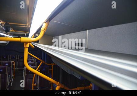 Overhead luggage rack of Royal Trans bus - Stock Image