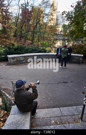 Street musician playing the trumpet in Central Park South - Stock Image