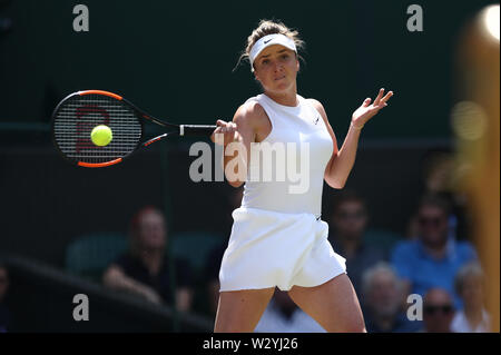 Wimbledon, UK. 11th July 2019, The All England Lawn Tennis and Croquet Club, Wimbledon, England, Wimbledon Tennis Tournament, Day 10; Elina Svitolina returns to Simona Help (rom) during their ladies singles semi-final match Credit: Action Plus Sports Images/Alamy Live News - Stock Image