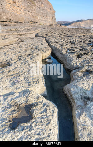 A Tidal Pool in a long crack along the shoreline of Dunraven Bay in Southerndown, South Wales - Stock Image