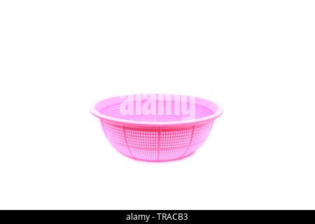 Pink plastic basket on isolated - Stock Image