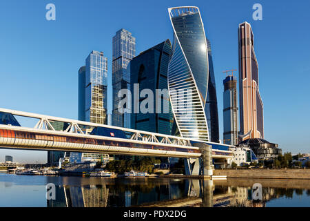 High rise buildings of Moscow International Business Centre (MIBC, or Moscow City) and Bagration pedestrian bridge. Moscow, Russia. - Stock Image
