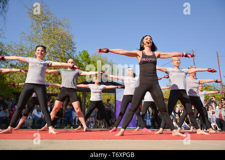 Nis, Serbia - April 20, 2019 Big group of people with instructor training Piloxing sport on sunny spring day - Stock Image