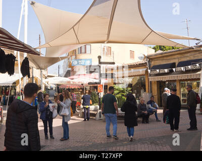 Small shaded square in the maket in the Turkish part of Nicosia Cyprus with cafes, benches and shops - Stock Image
