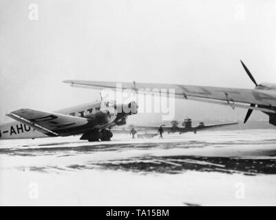 Junkers Ju52 are waiting for take-off at the snow-covered Berlin-Tempelhof Airport. - Stock Image
