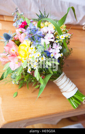 Bouquet bridal bouquet wild flowers wildflower colorful flowers blossom flower floral home window white vase vases - Stock Image