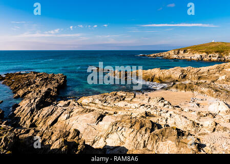 Calm waters at Fistral Beach and Headland, Newquay, Cornwall, UK - Stock Image