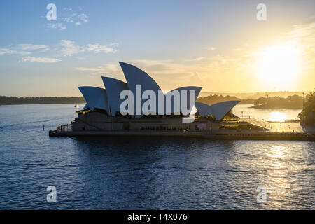 Dawn view of Sydney Opera House, a performing arts centre at Sydney harbour, New South Wales, Australia.  Designed by Jørn Utzon, it opened in 1973. - Stock Image