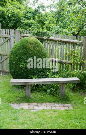 Bench in garden, Dorset, UK. - Stock Image