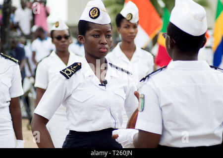 Abidjan, Ivory Coast - August 3, 2017: shoulder pad ceremony to students leaving the Maritime Academy. group of marine women dressed in white receivin - Stock Image