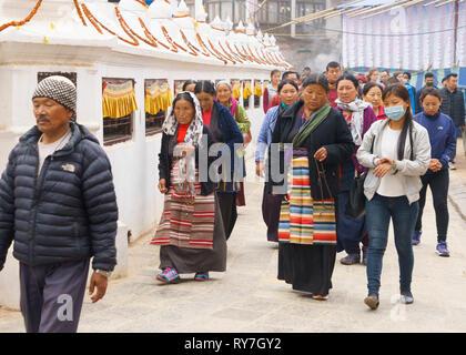Buddhist pilgrims making the kora around the Boudhanath Stupa, Kathmandu, Nepal. - Stock Image