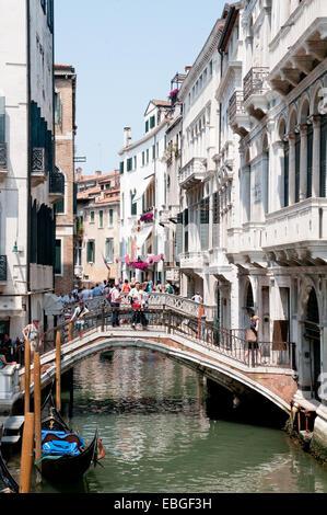 Bridges over canal Rio de la Canonica and a gondala in sunshine Venice Italy - Stock Image