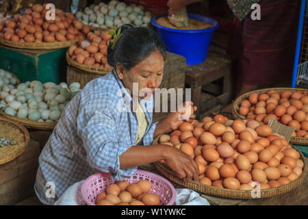 Egg seller at the Bagan marketthousand - Stock Image