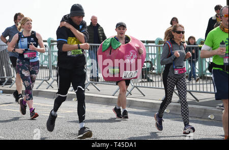 Brighton UK 14th April 2019 -   Thousands of runners some in fancy dress take part in this years Brighton Marathon which is celebrating its 10th anniversary Credit: Simon Dack/Alamy Live News - Stock Image