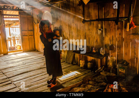A grandmother and her grandson in thier house in the countryside of Phongsali, Laos - Stock Image