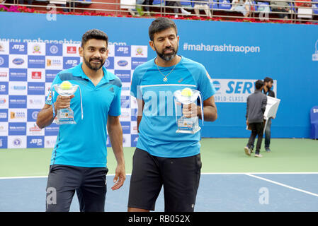 Pune, India. 5th January 2019. Divij Sharan and Rohan Bopanna, both of India, pose with their doubles championship trophies won at Tata Open Maharashtra ATP Tennis tournament in Pune, India. Credit: Karunesh Johri/Alamy Live News - Stock Image