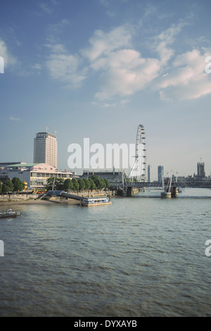 View of London's South Bank area with the London Eye, the Shell building and the Royal Festival Hall seen from Waterloo Bridge. - Stock Image