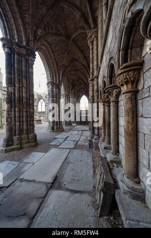 Ruined Holyrood Abbey at Palace of Holyroodhouse in Edinburgh, Scotland, UK - Stock Image