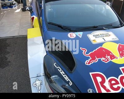 Ford Fiesta RS WRC rally car as driven by Sebastien Ogier and co-driver Julien Ingrassia shown at donnington park race circuit at the RS owners club national day 2017 fresh from a rally with battle scars - Stock Image
