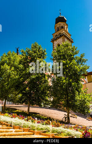 Church, tower and fountains at Levico Terme, Trentino, Italy - Stock Image