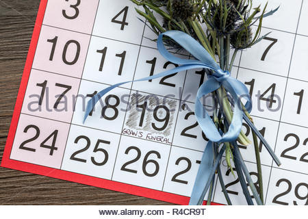 Gran's Funeral written on a calendar page and a posy of thistles - Stock Image