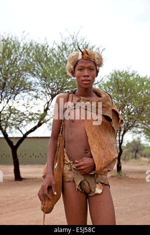 San  bushman in traditional dress, Ghanzi, Botswana, Africa - Stock Image