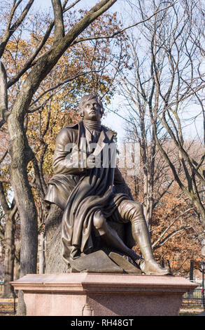 Statue of Robert Burns in Central Park vertical: Bronze statues of famous historic figures like Robert Burns decorate the pathways in Manhattan's famous Central Park. - Stock Image