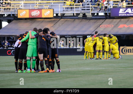 Mapfre stadium, USA. 23rd April, 2016. .Both Columbus Crew SC and Houston Dynamo huddle before the match between - Stock Image